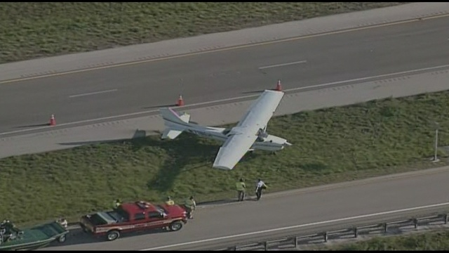 Small plane on roadway