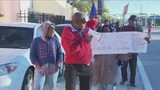 Little Haiti protesters outraged with former president
