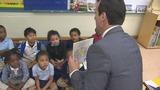 U.S. Attorney Wifredo Ferrer helps students learn to read