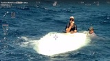 2 men rescued from capsized boat near Jupiter Inlet