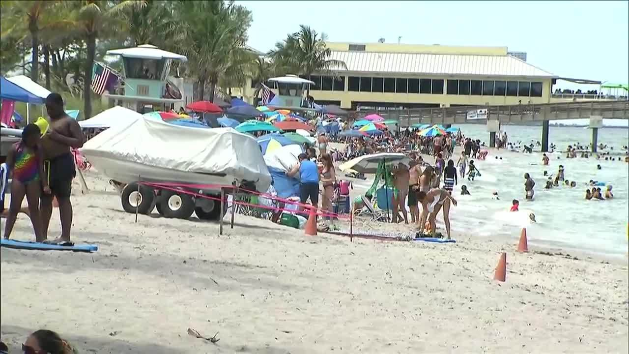 Beachgoers Show Appreciation For Troops Veterans On