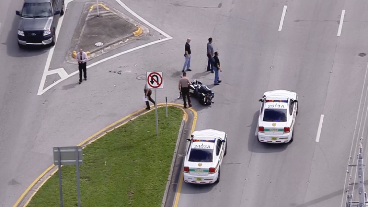 Miami Dade Police Motorcyclist Collides With Minivan In