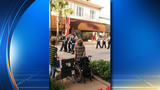 Florida teen in wheelchair rises to honor American flag
