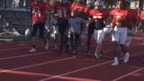 Football team rallies to help boy finish race