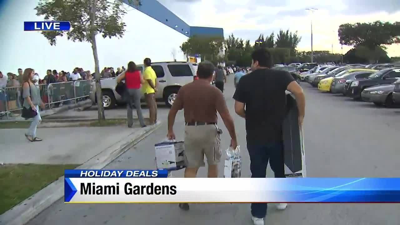 shoppers wait in line to shop at brandsmart in miami gardens