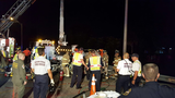 Crash leaves 2 hurt, worker trapped in bucket truck