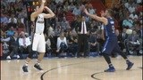 Heat point guard Goran Dragic (32 points) burns Mavs in 99-95 win