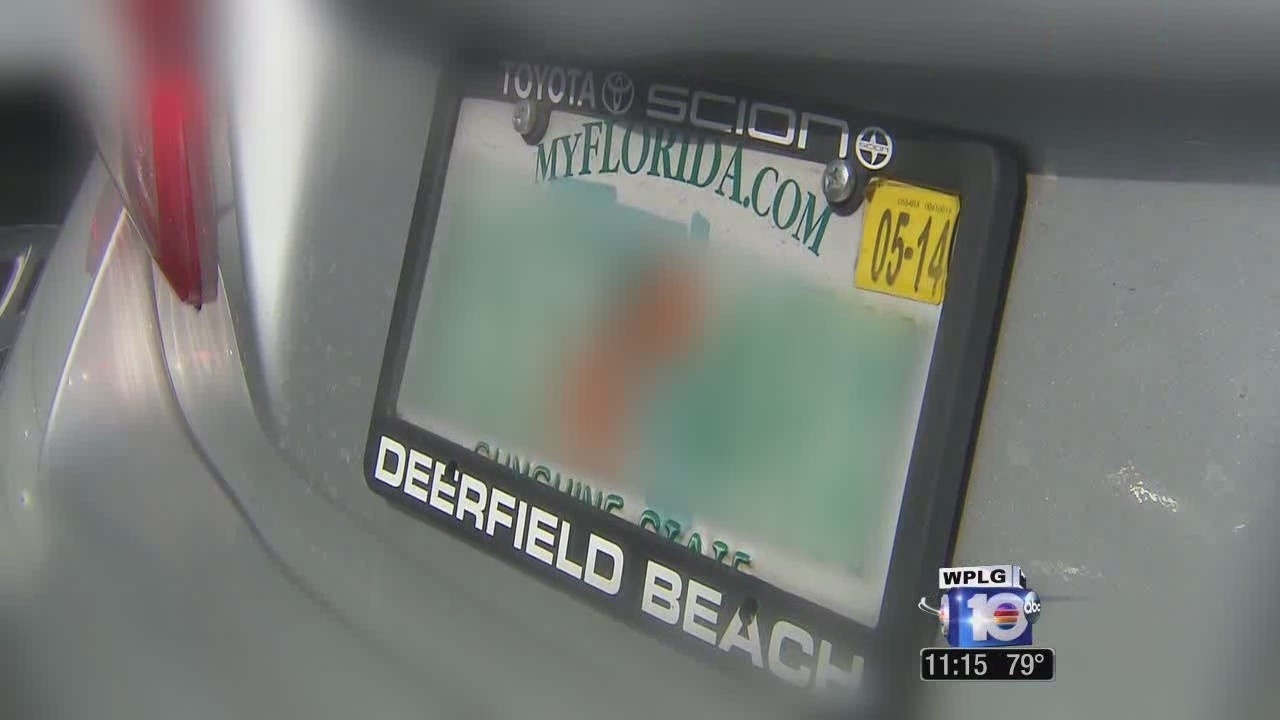 Drivers may be fined if license plate trim covers part of Fla....