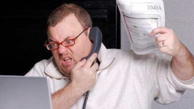 Taxes, upset, angry taxpayer on phone, forms