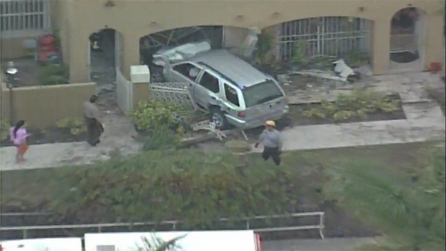 SUV into house_18057364