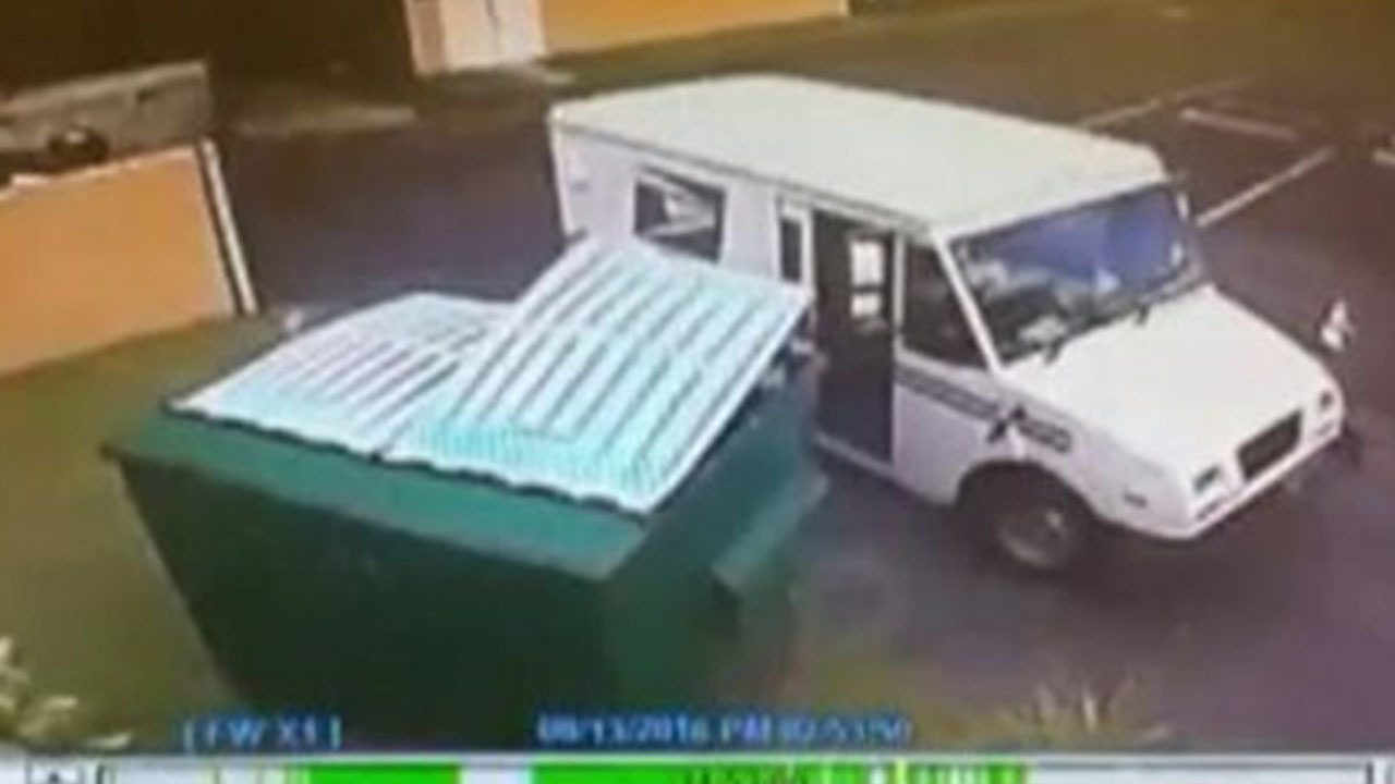 fla  postal worker caught throwing mail in trash