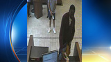 Surveillance image shows robber leaving North Miami Chase Bank with wad of cash