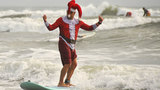 Hundreds of surfing Santas show off in Cocoa Beach