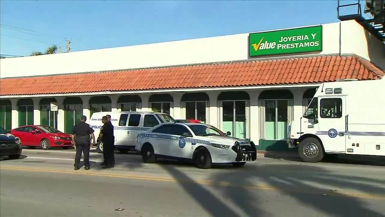customer killed during robbery at miami pawn shop