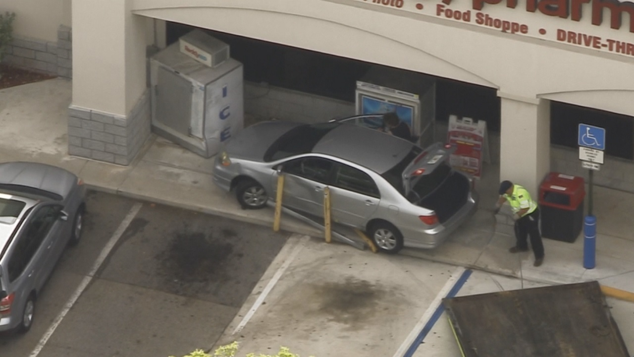car crashes into ice machine outside hollywood cvs pharmacy