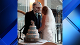 British man marries bride while wearing Dolphins helmet
