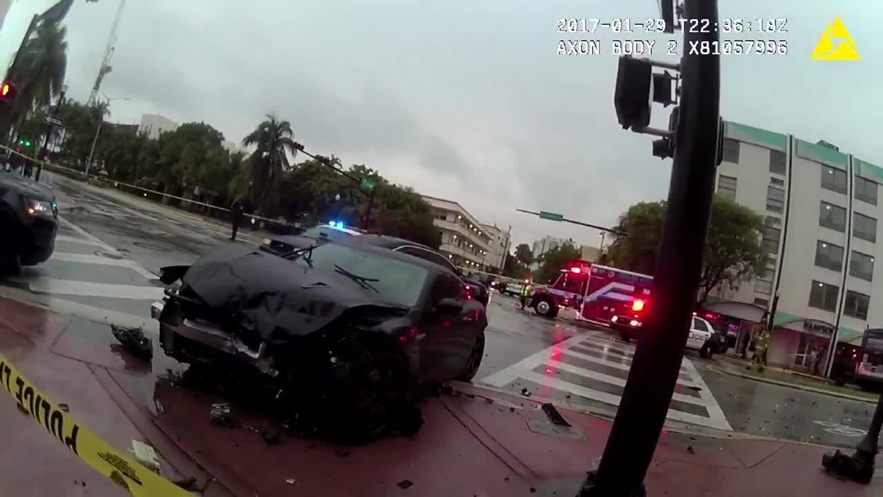 Police bodycam video shows pursuit ending with car crashing...