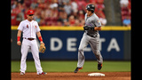 JT Realmuto homers twice, Marlins beat slumping Reds 5-4