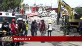 Families wait for news of Mexicans buried alive after earthquake