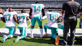 Dolphins owner locks arms with players for national anthem
