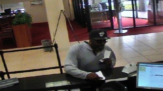Man in Miami Heat hat robbing BB&T in Tamarac