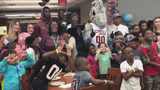 Young Hurricanes fan flashes 'U' sign during Seminoles photo session