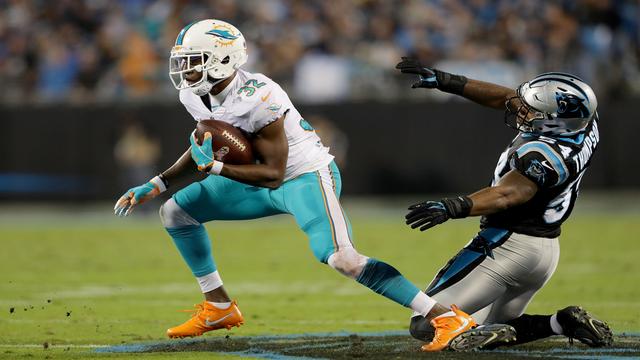 Miami Dolphins RB Kenyan Drake gets away from Carolina Panthers Shaq Thompson
