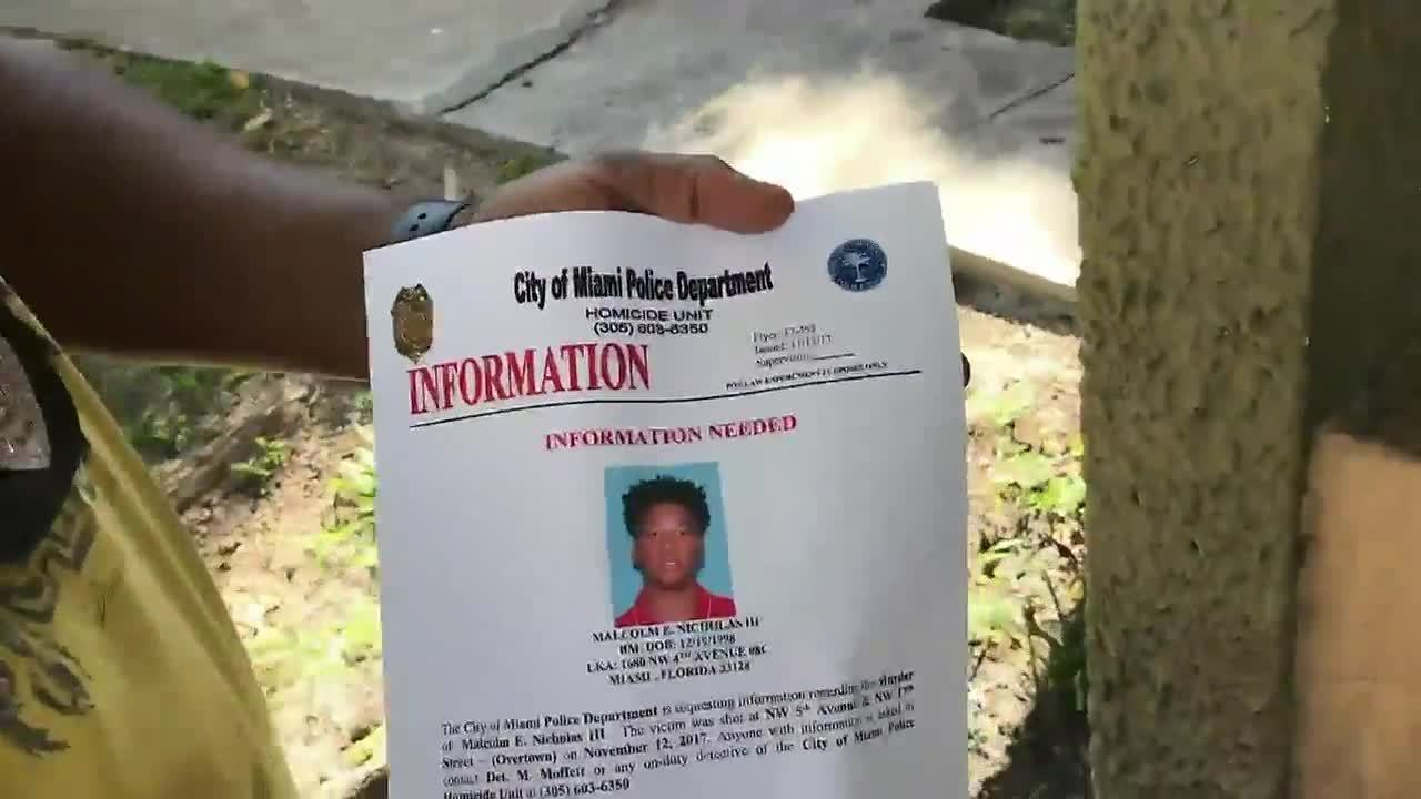 Miami police pass out fliers in hopes of finding...