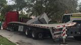 Sculpture bound for Miami museum falls, destroys truck