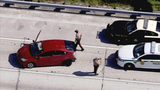 Police search for group of people who bailed out of car on I-95 in Miami
