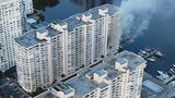 Firefighters work to extinguish apartment fire in Miami-Dade