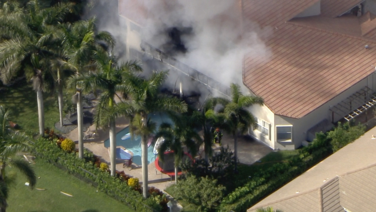Firefighters Rescue Pets During House Fire In Weston