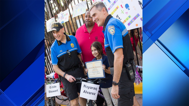 Nayaraq Alvarez awarded bike by Miami Beach police