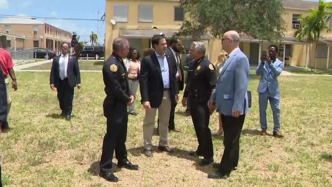 Sen. Marco Rubio tours Miami\'s Liberty City public housing...