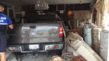 Truck crashes into rug store in South Miami