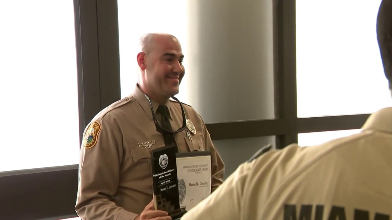 Miami-Dade police officer receives Purple Heart after killing...