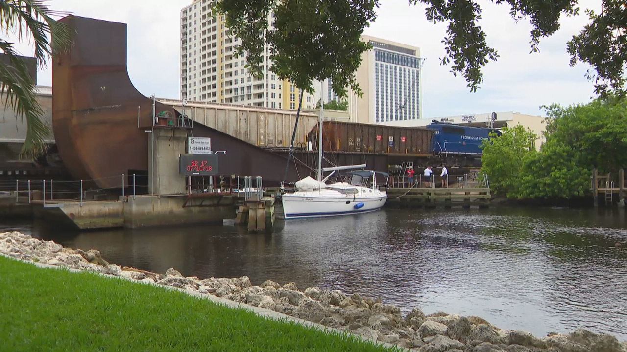 Boat Caught Under Railroad Bridge As It Lowers Over New River