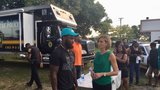 Miami Dolphins bring cheer and hot meals to victims of arson fire