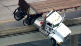 Semi-trailer truck is left partially dangling in Sarasota