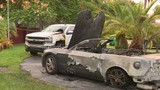 Surveillance video shows men setting vehicles on fire in southwest Miami-Dade