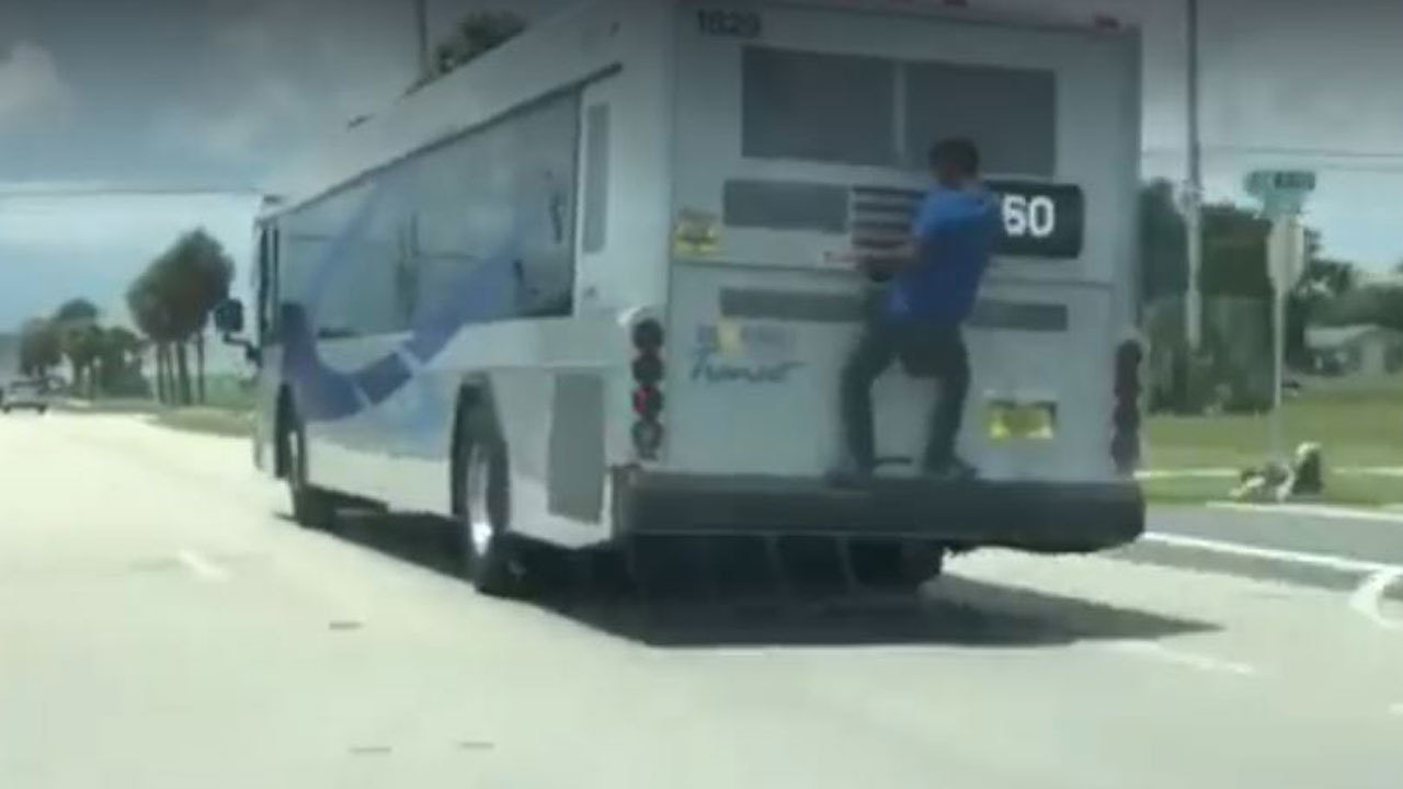 Video shows man's free ride on rear bumper of public bus
