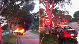 Davie police rescue driver before crashed car catches fire