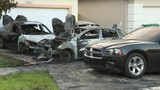 Cars believed to have been set on fire early Thursday outside Miami-Dade home