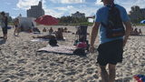 Neighbors hit the beach with a message: Watch your stuff