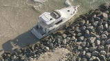 Cabin cruiser gets beached along jetty at South Pointe Park Pier