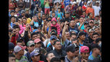 Photos: Thousands of Honduran migrants head toward U.S. in caravan