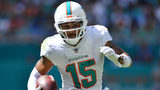WR Wilson leaves Dolphins game with leg injury