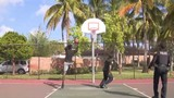 Plantation police officers play basketball with teen they met at youth center