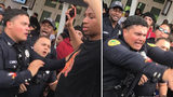 Police investigating after video shows officers losing cool amid unruly crowd