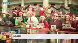 Christmas carolers spread joy during Big Bus Toy Express stop in Miami